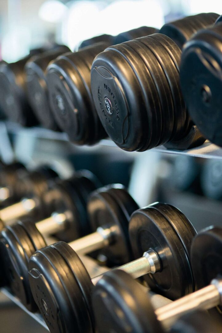 bodybuilding-close-up-dumbbells-equipment-260352